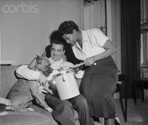 Belson, Bailey with their pet Mr. Riley. Image by © Bettmann/CORBIS
